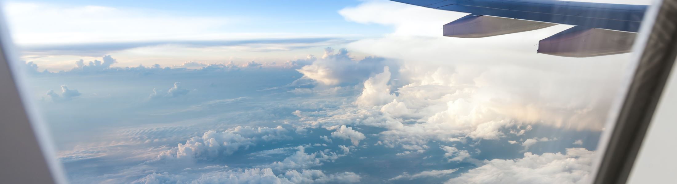 Clouds and sky as seen through a plane window